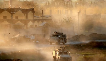 U.S. army vehicles supporting the Syrian Democratic Forces, Hajin, Syria, December 15, 2018.