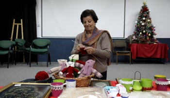 A woman makes crafts for Christmas, Nazareth, December 12, 2018.