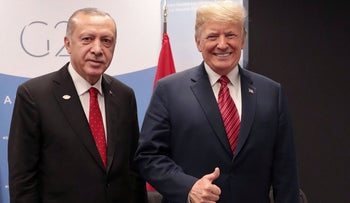 Turkey's President Recep Tayyip Erdogan posing with US President Donald Trump during the G20 summit in Buenos Aires, Argentina, December 1, 2018.