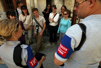 File photo: A tour group speaks with TIPH observers during a tour in Hebron, August 3, 2009.