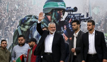Gaza Hamas leader Ismail Haniya (3rd-R) waves upon his arrival at a rally marking the 31st anniversary of Hamas' founding, in Gaza City December 16, 2018.