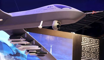 In this Feb. 25, 2018 file photo, a model of the Wing Loong II weaponized drone for the China National Aero-Technology Import & Export Corp. is displayed at a military drone conference in Abu Dhabi, United Arab Emirates. According to a report by the Royal United Services Institute, or RUSI released Monday, Dec. 17, 2018