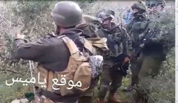 Israeli soldiers shoulder to shoulder with Lebanese soldiers in southern Lebanon, December 17, 2018.