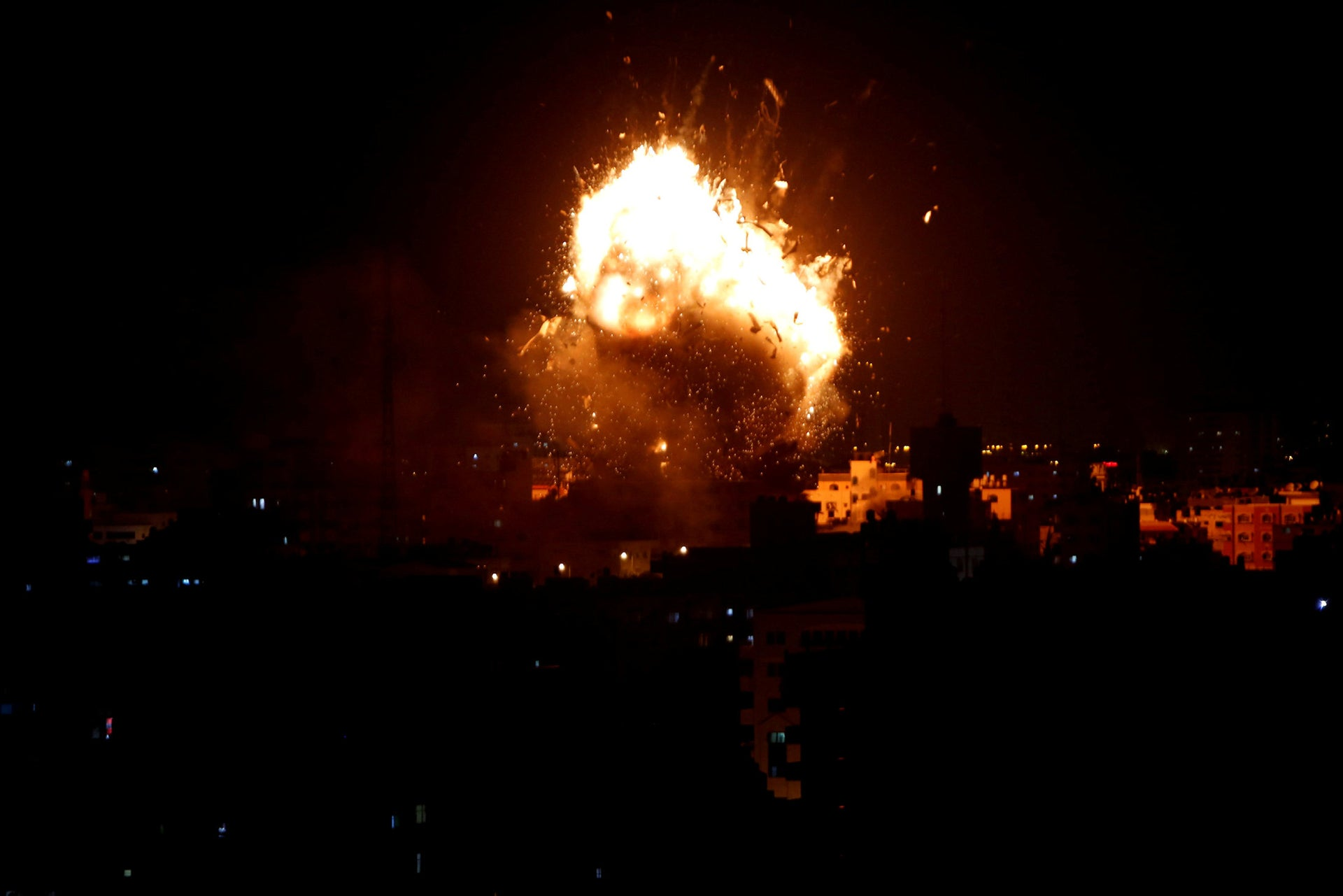 An explosion is seen during an Israeli air strike on Hamas's television station, in Gaza City, November 12, 2018.