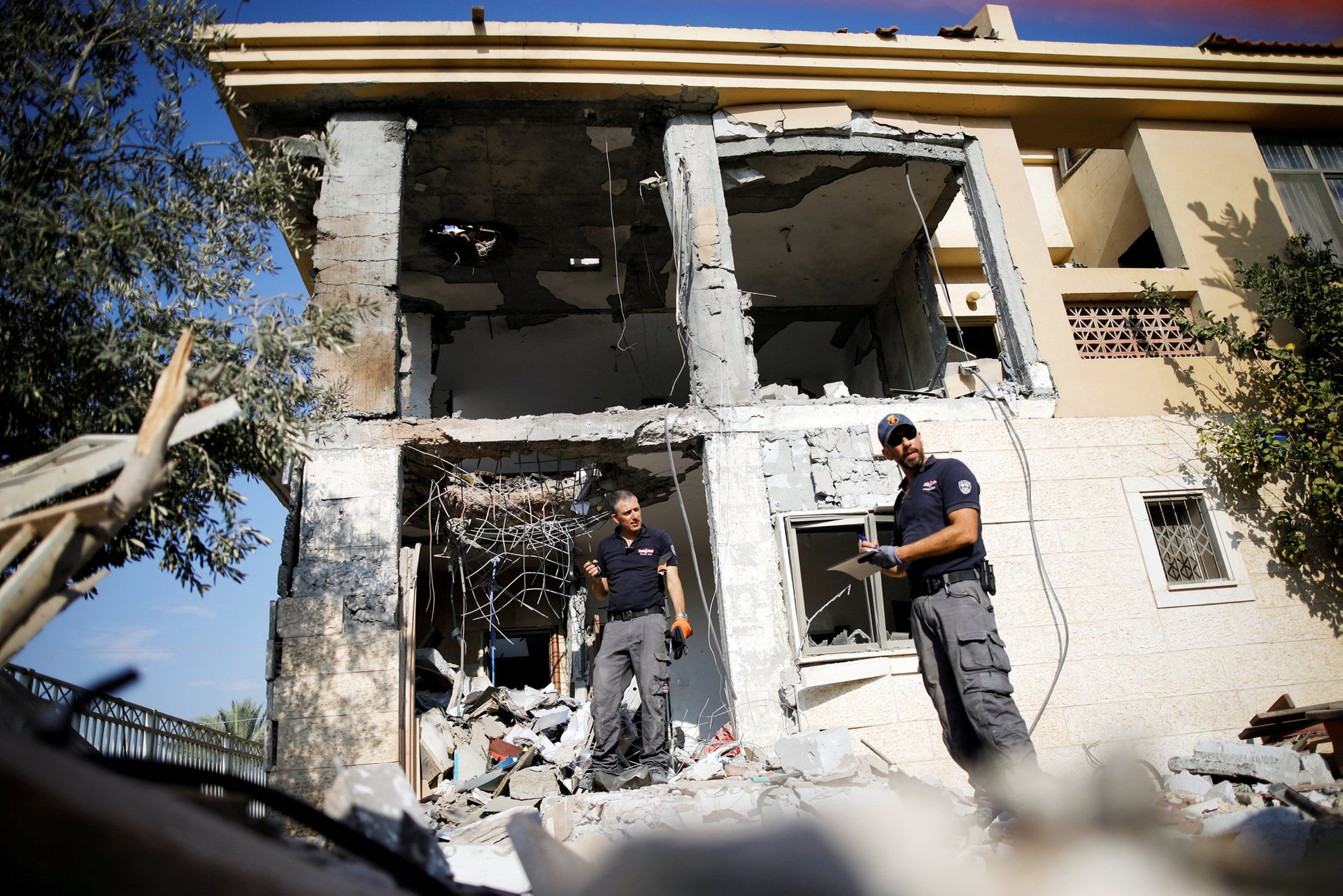 Israeli sappers work on a house that the Israeli military said was hit by a rocket fired from the Gaza Strip, in Beersheba, southern Israel October 17, 2018.