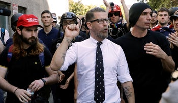 In this April 27, 2017 file photo, Gavin McInnes, center, founder of the far-right group Proud Boys, is surrounded by supporters after speaking at a rally in Berkeley, Calif.