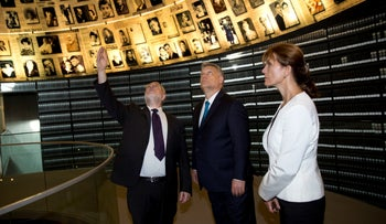 File photo: Hungarian Prime Minister Viktor Orban, center, and his wife Aniko Levai visit the Hall of Names at the Yad Vashem Holocaust Memorial in Jerusalem, July 19, 2018.