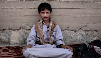 Abdel-Hamid, a 14-year-old former child soldier, poses for a photograph at a camp for displaced persons where he took shelter, in Marib, Yemen, July 27, 2018.