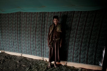 Nawaf, a 15-year-old former child soldier, poses for a photograph at a camp for displaced persons where he took shelter with his family, in Marib, Yemen, July 27, 2018.