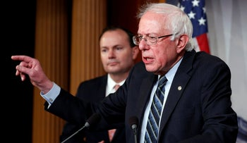FILE PHOTO: Senator Bernie Sanders speaks on Capitol Hill in Washington, U.S., December 13, 2018