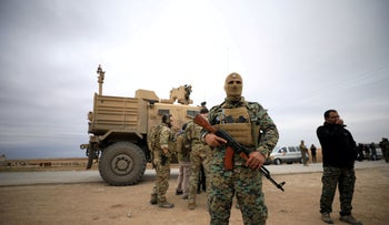 Syrian Democratic Forces and U.S. troops during a patrol near Turkish border in Hasakah, Syria November 4, 2018