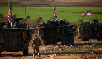 FILE PHOTO: A convoy of U..S forces armoured vehicles drives near the village of Yalanli, on the western outskirts of the northern Syrian city of Manbij