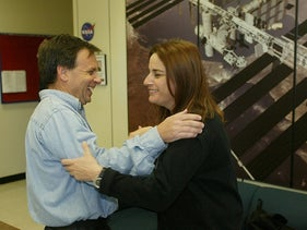 Israeli astronaut Ilan Ramon shares a light moment with his wife Rona following a Space Shuttle crew news conference, January 3, 2003.