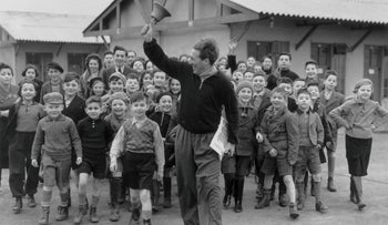 A camp leader ringing the dinner bell at a camp for young Jewish Kindertransport refugees from Germany and Austria, at Dovercourt Bay, near Harwich, January 11, 1939.
