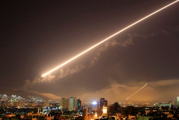 Surface to air missile fire lights up the sky over Damascus at the U.S. launches an attack on Syria early on April 14, 2018