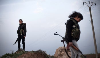 ARCHIVE - Kurdish fighters near the northeastern city of Qamishli, Syria, March. 3, 2013