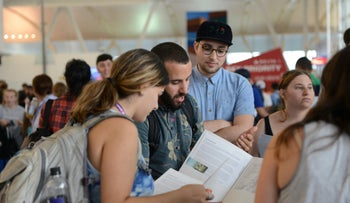 IfNotNow activists talk with young American Jews embarking to Israel for Birthright at JFK airport in New York City. July 30th 2018. Credit: Gili Getz