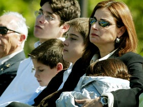 Rona Ramon listens as President Bush speaks at a memorial service February 4, 2003 for the seven astronauts killed in the space shuttle Columbia disaster.
