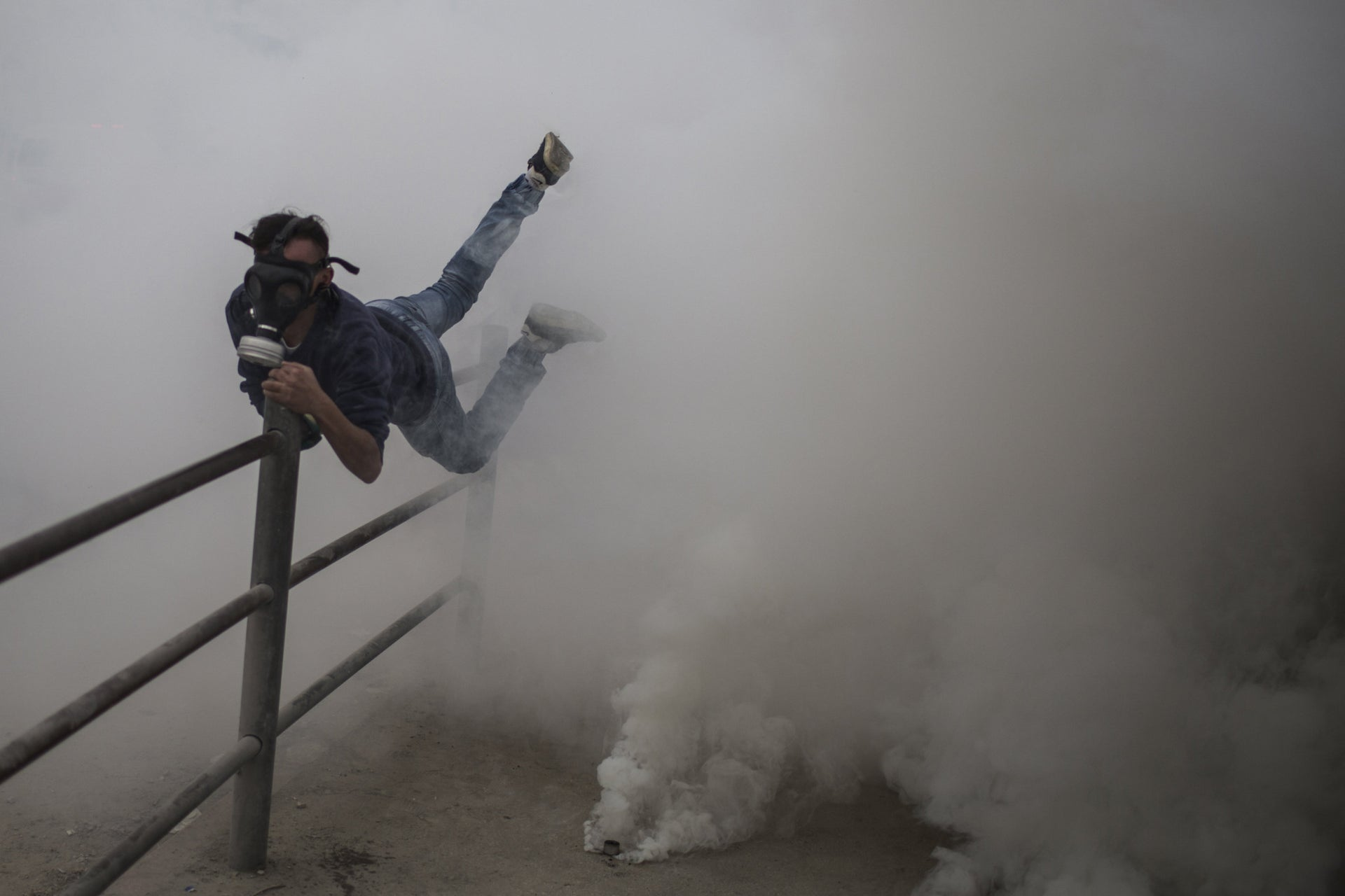 Single News photo winner: A Palestinian youth amidst a conflict with IDF soldiers, West Bank.