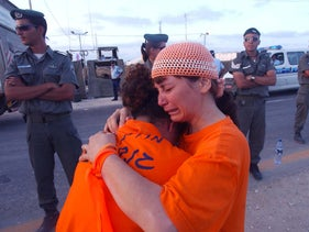An Israeli settler weeps at a checkpoint on the Gaza border, 2005.