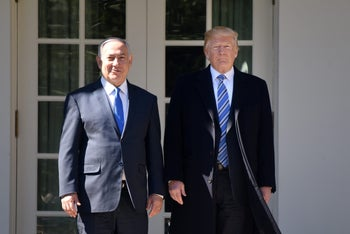 U.S. President Donald Trump and Benjamin Netanyahu stand for photographs outside the White House in Washington, D.C., U.S., on Monday, March 5, 2018.