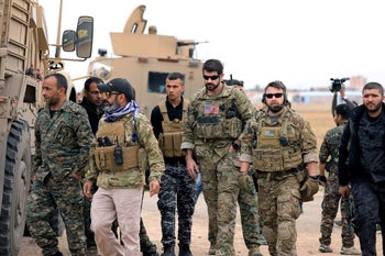 Syrian Democratic Forces and U.S. troops during a patrol near Turkish border in Hasakah, Syria, November 4, 2018.