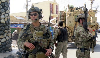 FILE PHOTO: U.S troops keep watch during an official visit in Farah province, Afghanistan May 19, 2018.