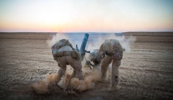 U.S. Marines fire mortars from an undisclosed location in Syria, September 10, 2018.