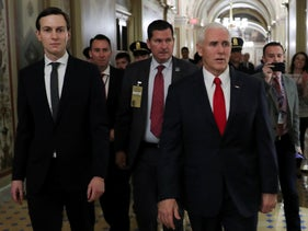 U.S. Vice President Mike Pence and White House senior adviser Jared Kushner walk between meetings at the U.S. Capitol in Washington, December 21, 2018.