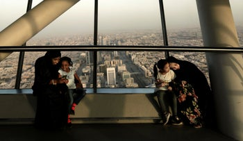 Women hold their daughters as they visit the Four Seasons Skyline Tower, Riyadh, Saudi Arabia, December 18, 2018.