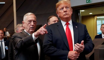U.S. President Donald Trump walks in with then-U.S. Defense Secretary Jim Mattis as they arrive at the multilateral meeting of the North Atlantic Council, Brussels, Belgium, July 11, 2018.