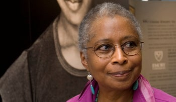 Alice Walker stands in front of a picture of herself from 1974 as she tours her archives at Emory University, in Atlanta. April 23, 2009