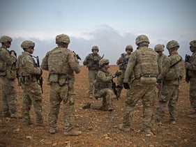U.S. soldiers gather for a brief during a combined joint patrol rehearsal in Manbij, Syria, November 7, 2018.
