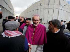 The acting Latin Patriarch of Jerusalem Pierbattista Pizzaballa arrives through an Israeli checkpoint to attend Christmas celebrations in Bethlehem, West Bank, December 24, 2018.