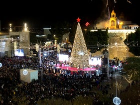 Christians celebrate the lighting of the Christmas Tree in Manger Square, Bethlehem, December 1, 2018.