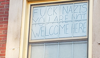 Nicole Parsons, a junior at the University of Massachusetts, Amherst, said she decided to put up this sign after a swastika was drawn over a Happy Hanukkah sign.