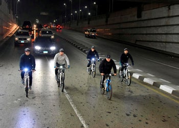 Egyptian President Abdel-Fattah el-Sissi rides his bike to the national Military Academy, in a suburb of Cairo, December 16, 2018.