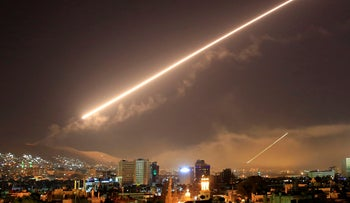 FILE PHOTO: Surface-to-air missile fire lights up the sky over Damascus as the U.S. launches an attack on Syria, April 14, 2018.