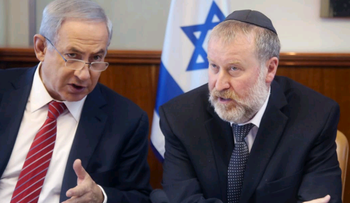 FILE Photo: Israel's Attorney General Avichai Mandelblit with Prime Minister Benjamin Netanyahu.