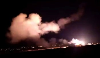 This frame grab from a video provided by the Syrian official news agency SANA shows missiles flying into the sky near Damascus, Syria, December 25, 2018.