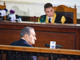 Egyptian judge Mohammed Shirin Fahmi (background) listens to the testimony of former president Hosni Mubarak (front), during the retrial of members of the now-banned Muslim Brotherhood on December 26, 2018.