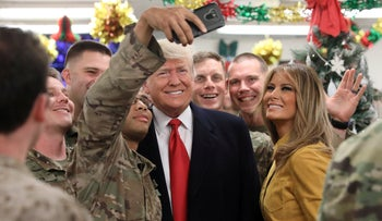 U.S. President Donald Trump and First Lady Melania Trump greet military personnel at the dining facility during an unannounced visit to Al Asad Air Base, Iraq December 26, 2018.
