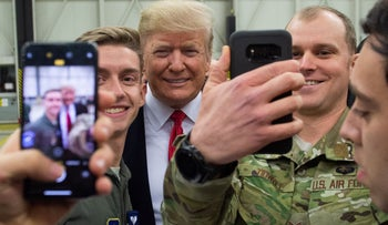 U.S. President Donald Trump greets members of the U.S. military during a stop at Ramstein Air Base in Germany, on December 27, 2018.