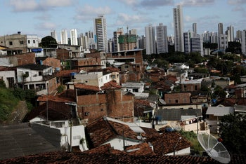 Houses stand in the Morro da Conceicao neighbourhood in front of high rises in Recife, Brazil, August 10, 2018.