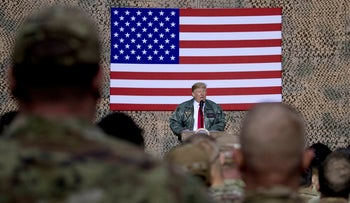 President Donald Trump speaks to members of the military at a hangar rally at Al Asad Air Base, Iraq, December 26, 2018.