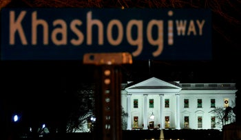 "A protest sign reading ""Khashoggi way"" is seen across the street from the White House in Washington, DC, on December 23, 2018."