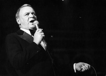 """Frank Sinatra singing at a concert in Israel in 1976, the proceeds of which went to charities and the """"Frank Sinatra Brotherhood and Friendship Center"""" in Nazareth."""