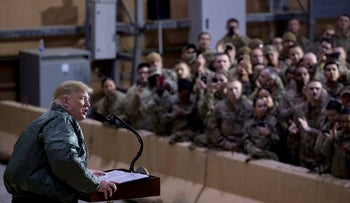 President Donald Trump speaks at a hanger rally at Al Asad Air Base, Iraq, December 26, 2018.