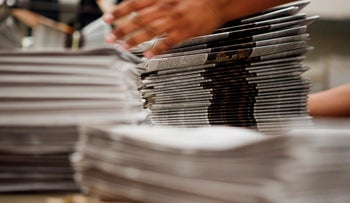File photo: Worker stacks copies of the Los Angeles Times newspaper in Los Angeles, California, U.S, October 16, 2013.