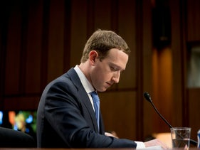 FILE- In this April 10, 2018, file photo Facebook CEO Mark Zuckerberg pauses while testifying before a joint hearing of the Commerce and Judiciary Committees on Capitol Hill in Washington about the use of Facebook data to target American voters in the 2016 election.